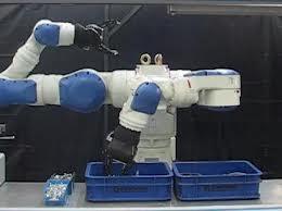 dual arm motoman with electric robotic hand