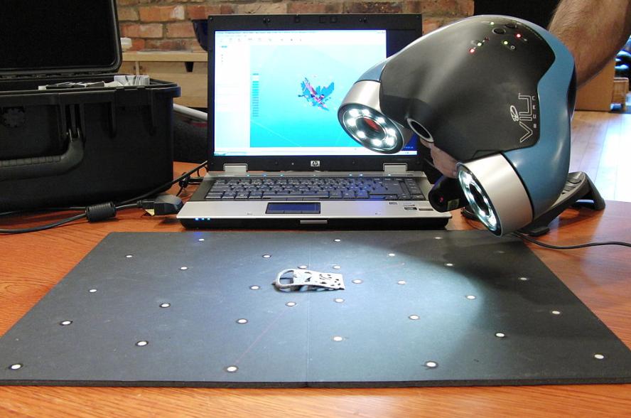 3D laser scanner scanning an object