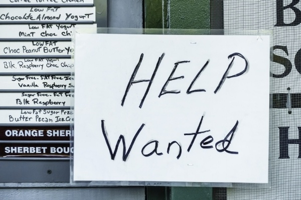 "Laminated handwritten ""Help Wanted"" sign in window of ice cream and yogurt shop in tourist town-979060-edited.jpeg"