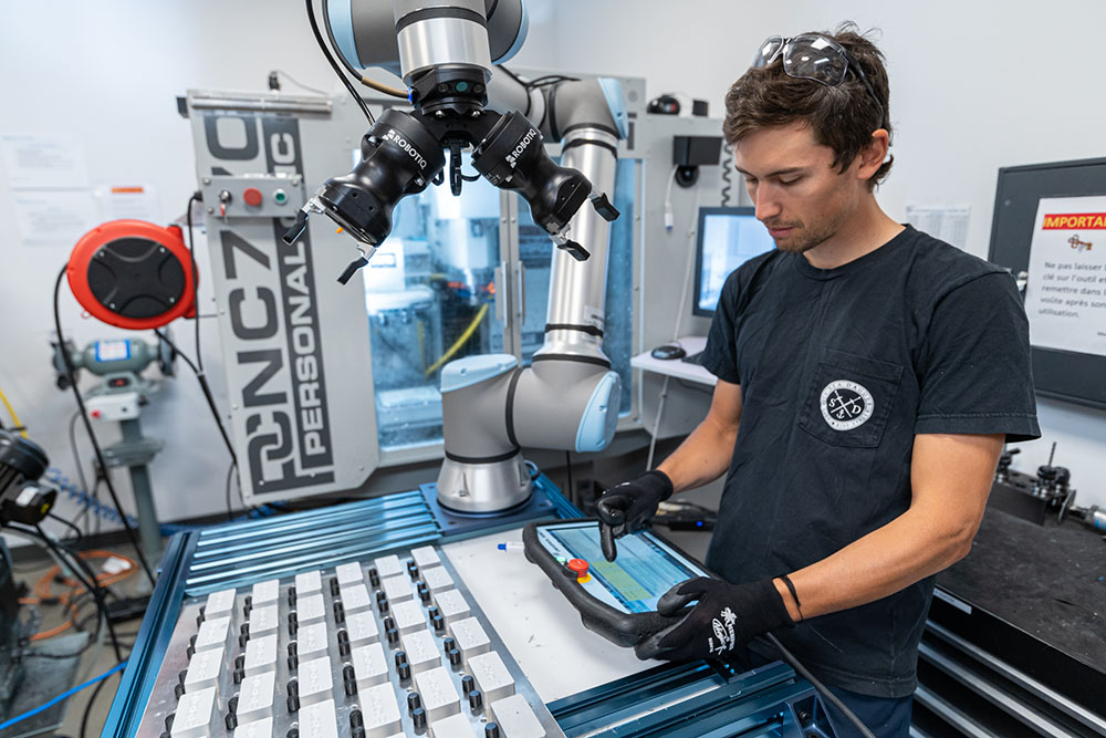 Person Working on Cobot - CNC Machine Tending Kit-1