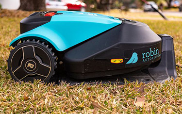 Mobile robot performing lawn care