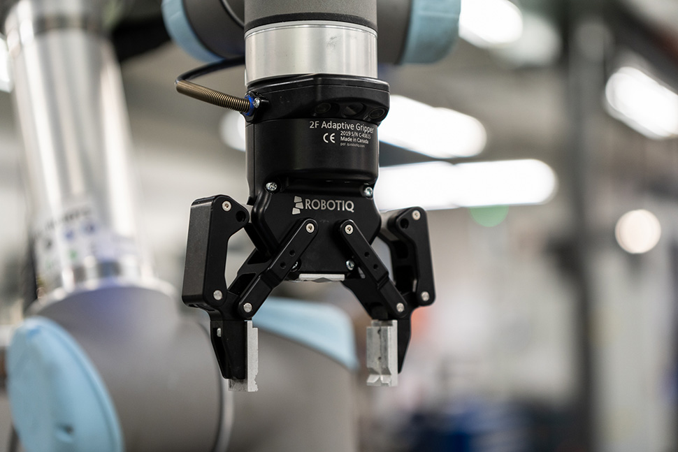 APN automated the parts-handling task with a Universal Robots UR5 and Robotiq 2F-85 Adaptive Gripper and Wrist Camera.
