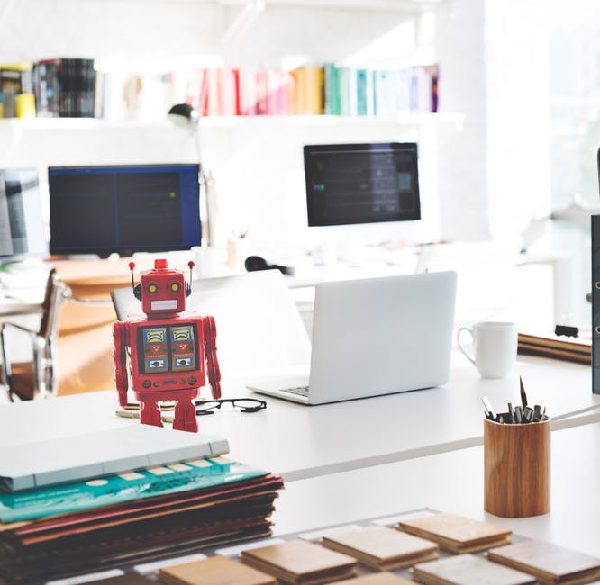 Robot-on-a-desk-next-to-a-laptop