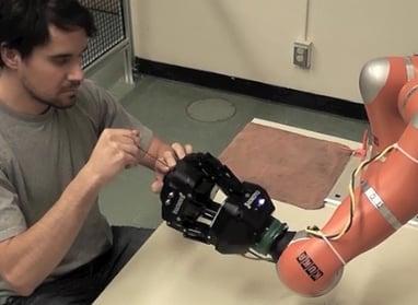 worker on kuka robot